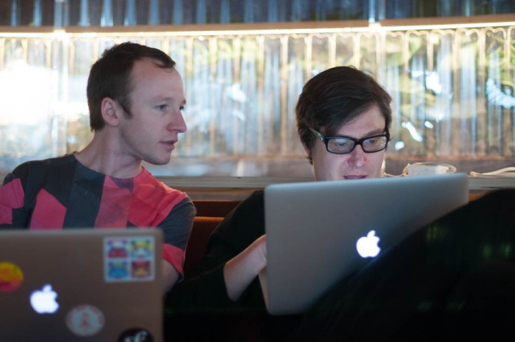 Two software engineers collaborating on work - both using Macs, naturally!