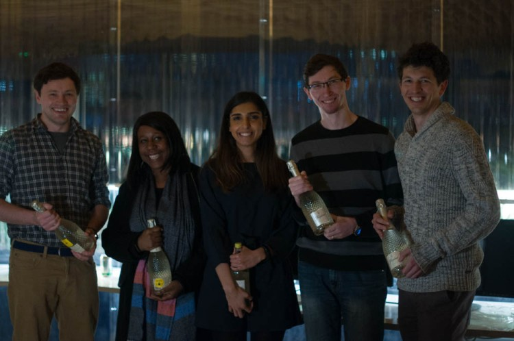 Team of 5 people with their prizes - a bottle of prosecco each